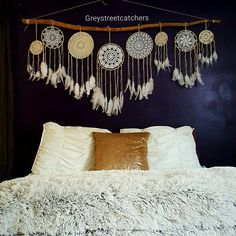 Just finished this customized Dreamcatcher wall hanging headboard. With 8 beautiful handmade Dreamcatchers with antique vintage crochet doilies. It's just beautiful!