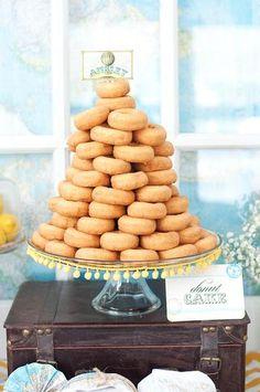donut tower with yellow pom pom ribbon