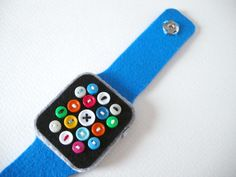 """Slow crafter Hiné Mizushima (previously) has created the wonderfully handcrafted """"(Super Low-Tech) Apple Watch,"""" which can help pass the time while waiting for the recently announced Apple Watch to. Cards Against Humanity App, Cool Mom Picks, Make Your Own, How To Make, Felt Diy, Smart Watch, Watch 2, Watch Bands, Crafts For Kids"""