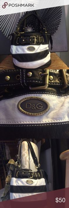 """Dolce & Gabbana from consignment shop, authentic ? Gorgeous bag , indeed, leather, or vegan leather exterior, with gold hardware, in EUC, minimal signs of wear, as seen in pics , paid 75.00, dimensions , 10"""" x 9"""", perfect size for essentials, cell phone, make up, and small brush and mirror 💜💜💜💜💜🌸🌸🌸🌸 Dolce & Gabbana Bags Totes"""