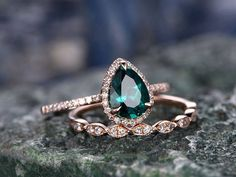 This ring is handmade by myself. The main stone is a 6x8mm Pear cut Lab treated emerald. The accent stones are natural conflict free diamonds. The material is solid 14k gold(white,yellow,rose gold available) Ring size can be choose from the selection box. The matching band is stacking #weddingring #weddingideas