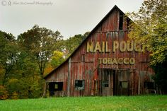 """""""Brown County Barn"""" Remnants of Americana can be seen along a rural road in southern Indiana. An advertisement for Mail Pouch Tobacco is evident on the side of a fading red barn. Emerging autumn colors lure visitors to Brown County. Set against the backdrop of the fall palette, a well-kept barn adds nostalgia to a casual drive along scenic routes."""