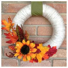 Off- white yarn wreath with sunflower, autumn leaves and mini pumpkin-12 inch  Another great idea for Fall