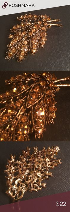 Vintage Gold and Amber Leaf Brooch Sparkly gold and amber rhinestone brooch. Unmarked. Can be worn as a brooch or as a pendant. Jewelry