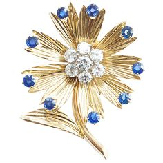 Lovely Van Cleef & Arpels Diamond Sapphire Gold Flower Brooch | From a unique collection of vintage brooches at https://www.1stdibs.com/jewelry/brooches/brooches/