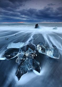Beached Ice - Jokulsarlon Iceland.  So beautiful and looks like the reaches of the end of the world!