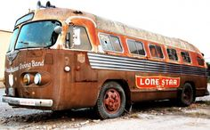 """1948 Flxible Clipper tour bus for """"The Texas Top Hands Western Swing Band"""" sits outside the Broken Spoke Dance Hall in Austin Texas. Hulk, Escuderias F1, Bus City, Converted Bus, Automobile, Vintage Rv, Vintage Travel Trailers, Bus Conversion, Abandoned Cars"""