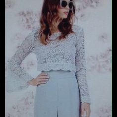 Lauren Conrad Lace Top Lovely light gray lace top with a scoop neck and long bell sleeves. Lace is soft to the touch. Can be worn with a Cami or layered with a dress either way it looks fabulous. Lauren Conared Tops Crop Tops