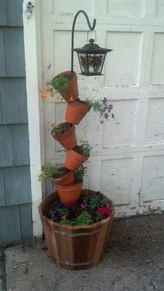 My version of terracotta planter.  Use a shepherd hook for rod and then hung a solar light from hook.