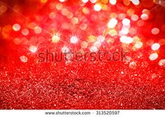Christmas lights Abstract red glitter background,