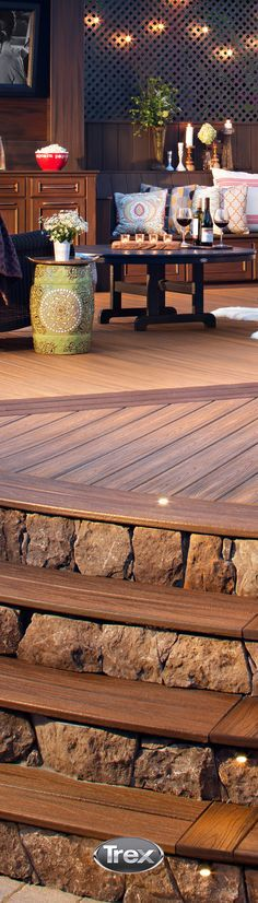 Evening Indoor entertaining transitions to the outdoors with stylish decking, stairs, lighting and large seating areas