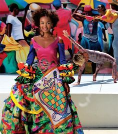 Haitian Fashion: The vibrant gown seen here, as well as some of the accessories in this feature, is from Vèvè Collections, a line produced in Haiti by Phelicia Dell, who incorporates symbols from Haitian culture in many of her designs.  Read more at http://oceandrive.com/living/articles/rediscovering-little-haiti#0jmIlXQIX53Vr3lr.99