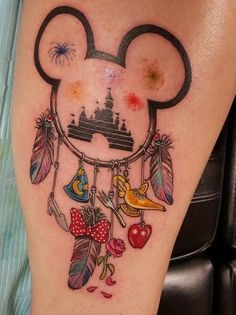"Disney inspired tattoo on lower leg/calf [   ""13495310 151351008606381 1706011985739411002 n Disney tattoos to impress your inner child Photos)"",   ""Tattoos are cool Disney tattoos are very cool."",   ""Disney Dream Catcher tattoo with the rose for beauty and beast compass for Pocahontas"",   ""So much going on in this tattoo. I wouldn"