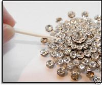 Stones and rhinestones in vintage jewelry that are glued, will occasionally come loose. That is because the glue that holds the stone in place has become old and is brittle and not enough glue was...
