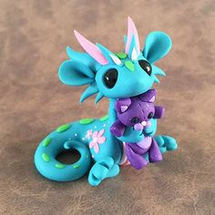Dragon with kitty teddy by Dragons&Beasties