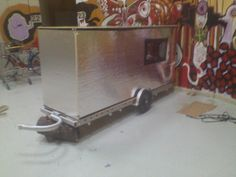 Here's a cool camper, made I believe with foil backed foam board.