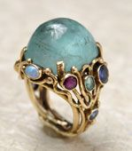 Arts & Crafts ring. 1890-1914.The Arts and Crafts movement coexisted with Art Nouveau, both emphasizing the aesthetic.  This era countered commercially mass-produced jewelry by emphasizing fine craftsmanship.