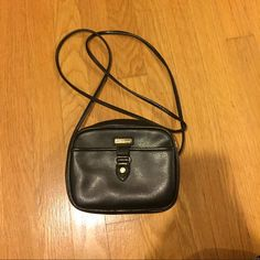 Liz Claiborne black crossbody bag This bag has been well-loved, and there is some flaking on the inside as a result of wear. This is shown in the pictures. The exterior is flawless though, and it's an adorable purse! Liz Claiborne Bags Crossbody Bags
