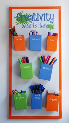 Cute art center!  Magnetic board and metal boxes!  Cover the boxes in some colorful vinyl, add some vinyl for the heading and around the edges and you have a great way to save space and still have an organized art center.
