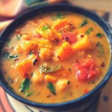 Moroccan Coconut and Chick Pea Soup. Pan sauté sweet potatoes, garlic, apples, onion and yellow pepper til onions are carmelized. Roast is oven until sweet potatoes are tender. deglaze on stovetop with some of vegetable broth. Purée skillet veggies and remaining broth. Put in pot and add remaining ingredients and cook. Add chicken breast. Serve with couscous