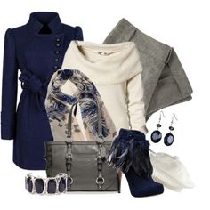 navy, cream, and gray.  I like the coat and the colors, not sure about the feathered booties - would have my cats chasing my feet!