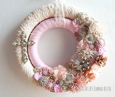 FREE SHIPPING Double Wrapped Lace and fabric Wreath in pink cream with handmade fabric and felt flowers with lots of bling.  Includes cross. by WreathsByEmmaRuth on Etsy https://www.etsy.com/listing/264169261/free-shipping-double-wrapped-lace-and