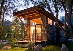 A luxury cabin with a fireplace and fire pit, against the mountains of neighboring Grand Teton National Park – includes room for up to four adults