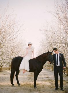 Bride on horseback. Almond orchard styled shoot ~ This Modern Romance