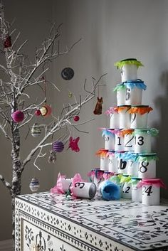 tin can advent calendar. Maybe let girls each make one for each other in November?!?
