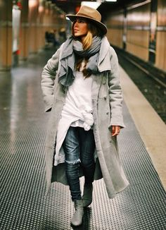 Maja Wyh rocks a beige brimmed hat, gray coat and ripped jeans