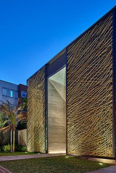 Bamboo panels within two large sliding doors. Designed for this project, Dinaflex, São Paulo. Architect Eduarda Corrêa