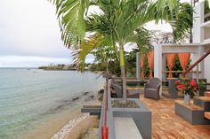 Featured Property: Unique #beachfront home in #Vieques boasts 3 levels of colorful and open spaces that cascade towards the ocean. #PuertoRico #LuxuryRealEstate ›