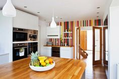 kitchen with colorful striped accent wall