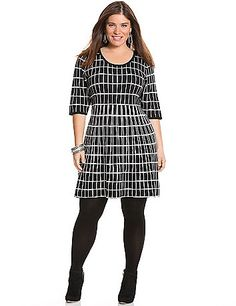 A trend-right  fit & flare silhouette and unique windowpane print give this soft sweater dress fashionable versatility for any day and any setting. Flattering scoop neck and seamed waist define curves to their advantage, with 3/4 sleeves for confident coverage. lanebryant.com