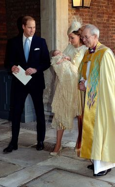 Catherine, Duchess of Cambridge carries her son Prince George Of Cambridge with Prince William, Duke of Cambridge as they leave the Chapel Royal following the christening with Archbishop of Canterbury, Justin Welby in St James's Palace.