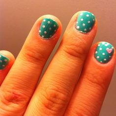 Turquoise nails with white polka dots and an accent nail with 1 small pink 3D heart easy free hand nail art, short nails