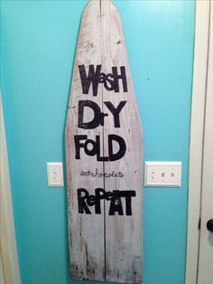 I used an old wooden ironing board to add character to my laundry room! JHK