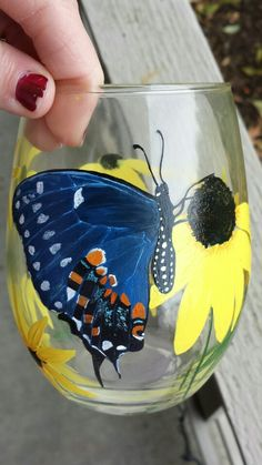 Hand painted butterfly wine glass. I painted this from a picture a woman sent me of a butterfly she personally raised in her garden! So cool! Her friend had me paint this glass to surprise her with.