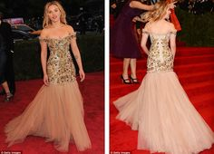 Twirling around in tulle: Scarlett Johansson was embellished and voluptuous in Dolce and Gabbana, but would've looked better in a deeper colour