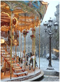 Carousel in snow. Paris, France