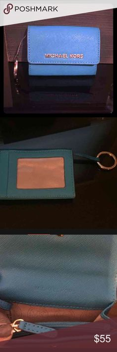 MK Jet Set Travel Coin Purse keychain! Bright blue with gold hardware, like new Michael Kors change purse, id holder and snap pocket key chain! Jet Set collectors item! Last pic is a stock photo to show the side view, actual item is the first 3 pictures! Michael Kors Bags Clutches & Wristlets