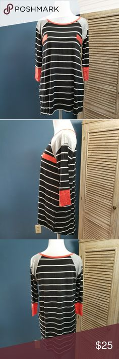 """Black White Stripe with coral tunic Black with white stripes tunic top.  Coral neckline, sleeves and chest design.  Baseball style sleeves, elbow length.  This top is extremely soft with some stretch.   Length: 28"""" Bust: 17"""" Tops"""