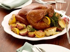 Lemon And Herb Roasted Chicken With Baby Potatoes from FoodNetwork.com