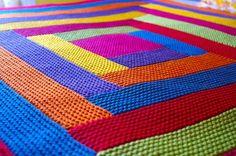 Log cabin knit blanket in chunky weight yarn.