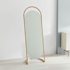 Our Folded Ellipse Standing Mirror dresses up bedrooms, entryways or walk-in closets with its sleek, antique brass frame—no leaning or mounting hardware required. Mirror Wall Art, Mirror Tiles, Floor Mirrors, Mirror Set, Decor Interior Design, Interior Decorating, Décor Antique, Antique Decor, Dressing Mirror