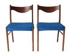 A pair of teak Danish Mid-Century Modern chairs with blue fabric. $325