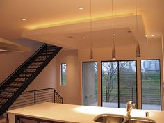 AMBIENT lighting - created at ceiling (above the bulkhead) potlights. TASK - pendant lights over kitchen island.