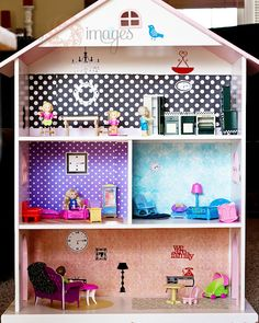 "great idea for a dollhouse;  i bet it wouldn't be too hard to use a regular bookshelf and just build a roof shaped ""attic"" on top."