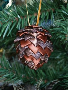 Pinecone Ornament: surprisingly simple to do by covering a styrofoam ball with scraps of ribbon!