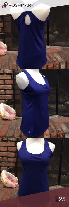 Athleta Strappy Tank size medium Athleta Strappy Tank size medium.  Beautiful royal blue tank with built in bra.  Lightly padded.  Breathable mesh fabric on back of tank.  Excellent condition Athleta Tops Tank Tops